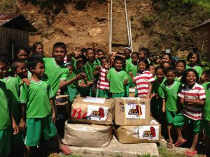 Kids at Rainbow Reading Gardens smile happily to receive shoes from Kick Andy Foundation