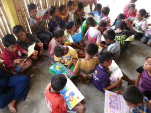 Photo 1: They are happy with the books!
