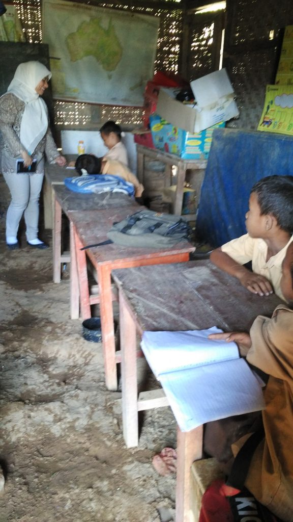 "During a school survey in Komodo, I asked ""hey, do you know how to read?"" she answered with a smile and later stared at the desk"