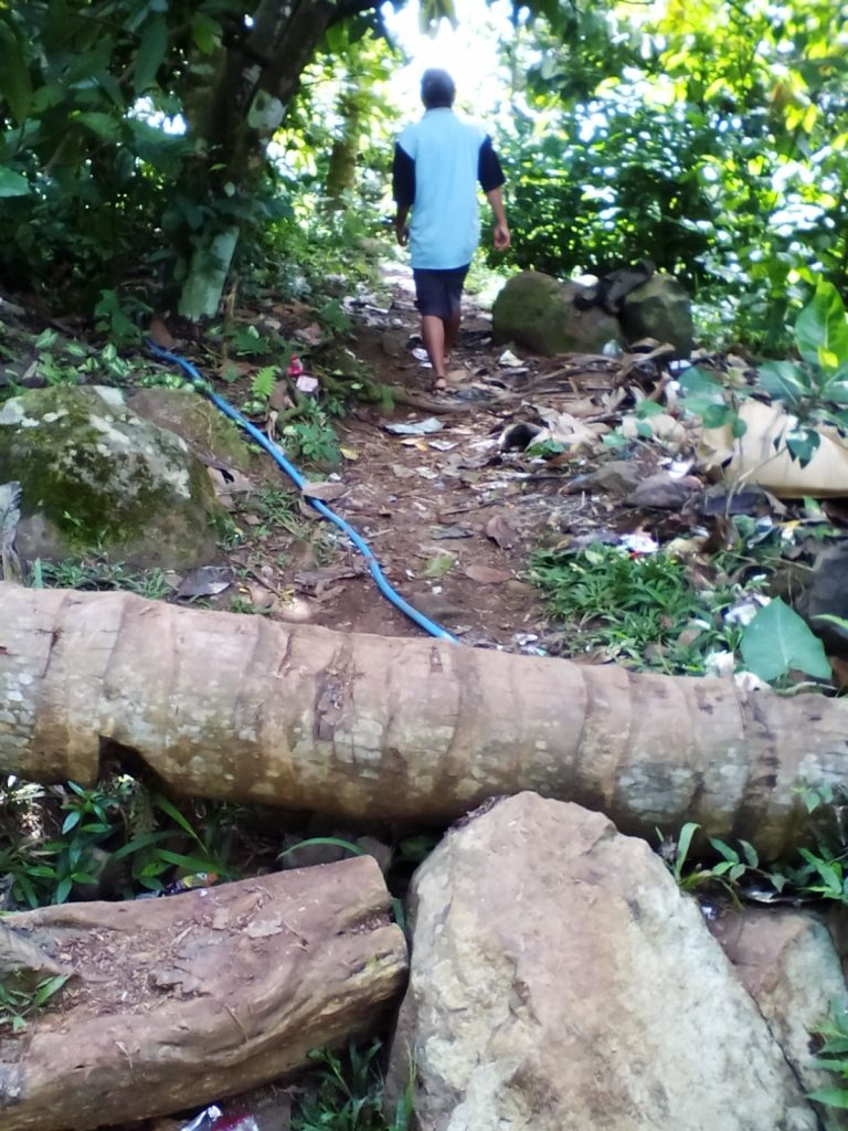 The road is blocked by a log, on the way to a school in Mbeliling Subdistrict